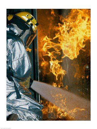 Framed Rear view of a firefighter extinguishing a fire Print