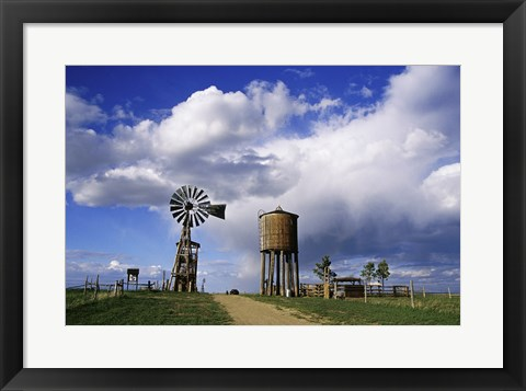 Framed Low angle view of a water tower and an industrial windmill, 1880 Town, South Dakota, USA Print