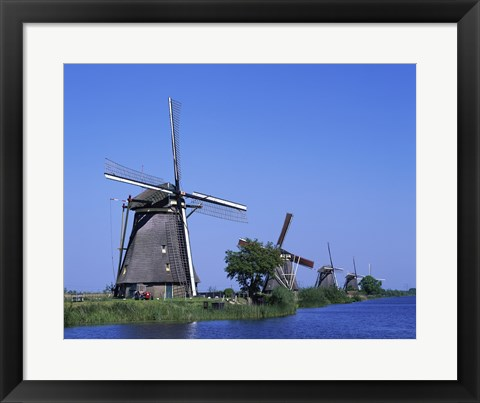 Framed Windmills along a river, Kinderdike, Amsterdam, Netherlands Print