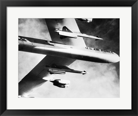Framed Low angle view of a bomber plane carrying missiles during fight, AGM-28 Hound Dog, B-52 Stratofortress Print