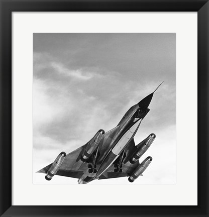 Framed Low angle view of a bomber plane in flight, B-58 hustler Print