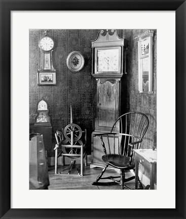 Framed Antique clocks in a living room Print