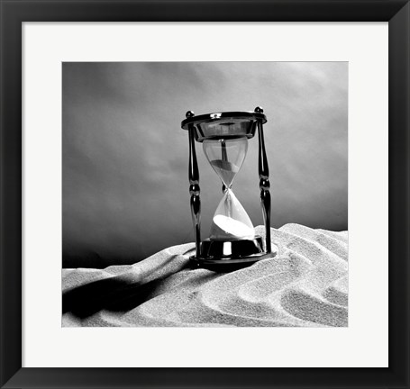 Framed Close up of hourglass on sand Print