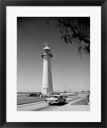 Framed USA, Mississippi, Biloxi, Biloxi Lighthouse with street in the foreground Print
