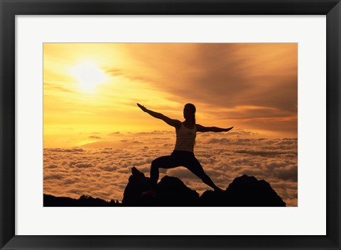 Framed Yellow silhouette of a young woman doing yoga, Hawaii, USA Print