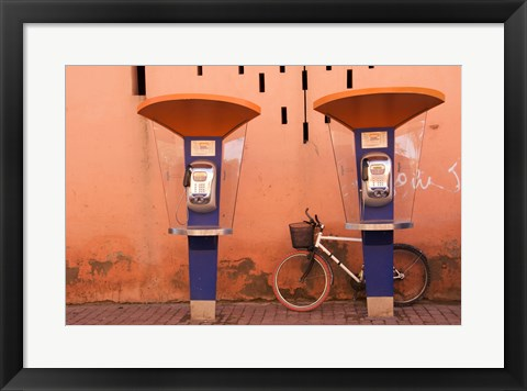 Framed Public telephone booths in front of a wall, Morocco Print