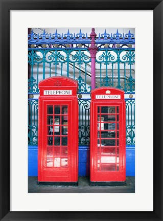 Framed Two telephone booths near a grille, London, England Print