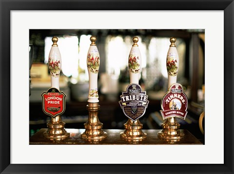 Framed Close-up of beer tap handles in a bar, London, England Print