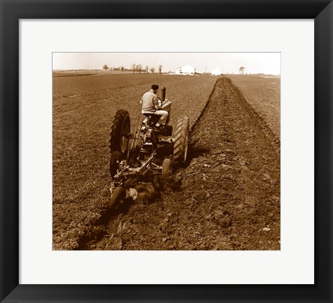 Framed USA, Pennsylvania, Farmer on Tractor Plowing Field Print