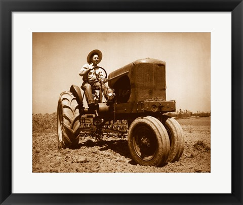 Framed Farmer Plowing a Field with a Tractor Print