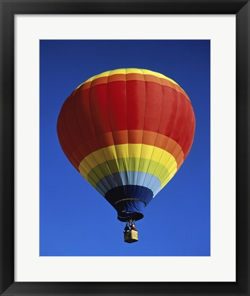 Framed Low angle view of a hot air balloon rising, Albuquerque International Balloon Fiesta, Albuquerque, New Mexico, USA Print