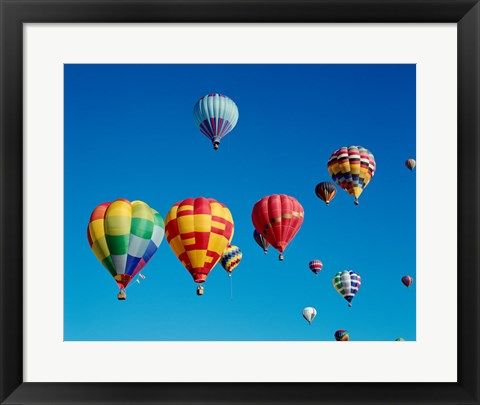 Framed Low angle view of a group of hot air balloons in the sky Print