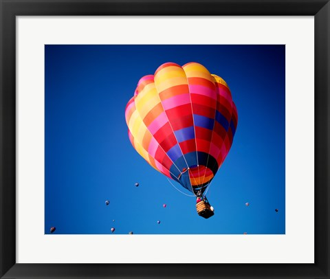 Framed Lone Hot Air Balloon with Other Hot Air Balloons in the Distance Print