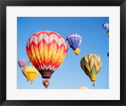 Framed Low angle view of hot air balloons in the sky Print