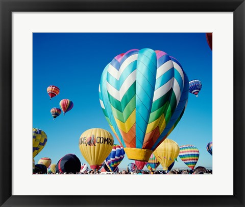 Framed Low angle view of hot air balloons taking off, Albuquerque International Balloon Fiesta, Albuquerque, New Mexico, USA Print