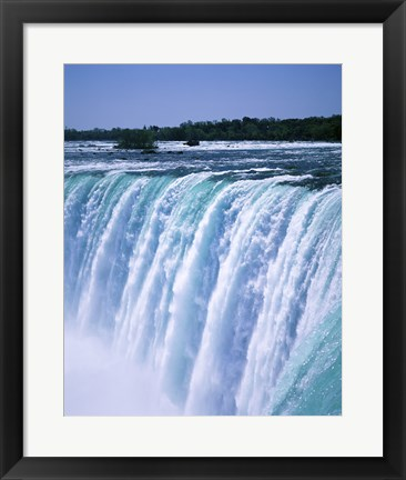 Framed Water flowing over Niagara Falls, Ontario, Canada Print
