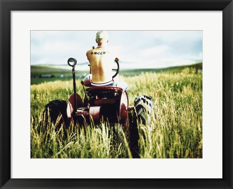 Framed Rear view of a farmer driving a tractor in a field, Oregon, USA Print