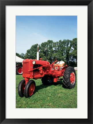 Framed Tractor in a field Print