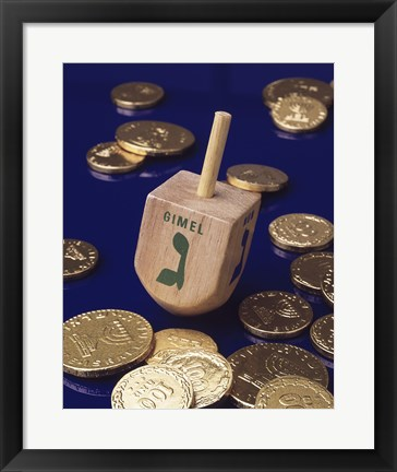 Framed Close-up of a Hanukkah dreidel with Hanukkah gelts Print