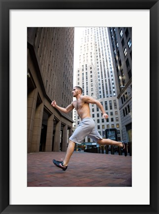 Framed Side profile of a young man running in a city Print