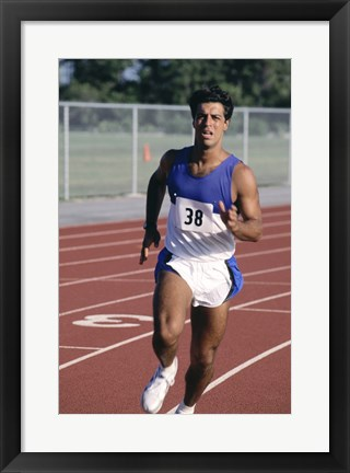 Framed Male athlete running on a running track Print