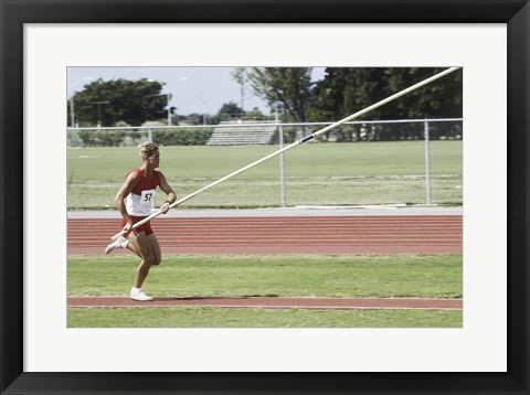 Framed Male athlete pole vaulting Print