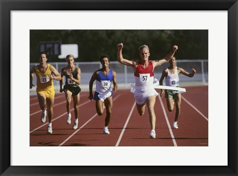 Framed Male athletes running on a running track Print