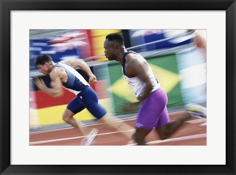 Framed Side profile of two young men running on a running track Print