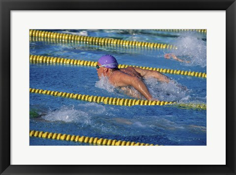 Framed Swimmer racing in a swimming pool Print