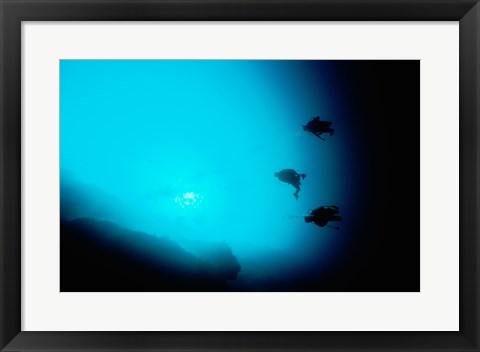 Framed Three scuba divers swimming underwater, Blue Hole, Belize Print