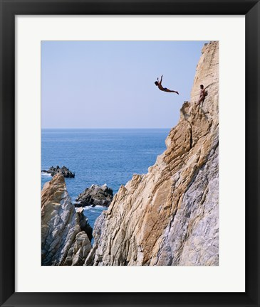 Framed Male cliff diver jumping off a cliff, La Quebrada, Acapulco, Mexico Print