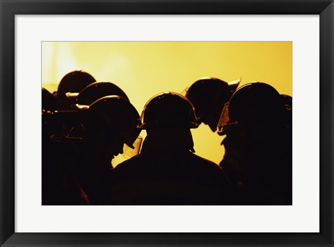 Framed Rear view of a group of firefighters looking down Print