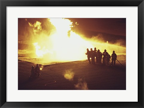 Framed High angle view of firefighters extinguishing a fire Print