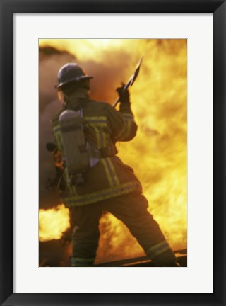 Framed Rear view of a firefighter holding an axe Print