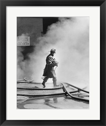 Framed Firefighter walking in front of smoke Print