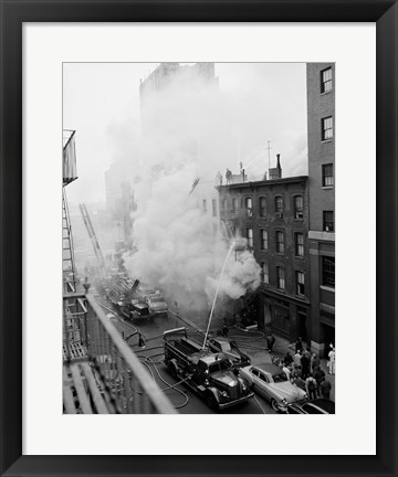 Framed New York City, Fire on East 47th Street, with fire engines shooting water on burning building Print