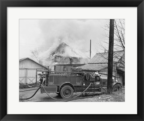 Framed Fire engine next to home in fire Print