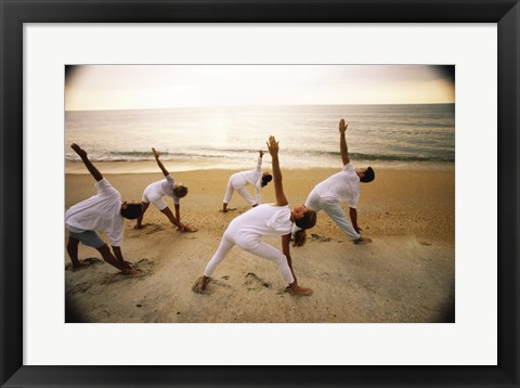 Framed Group of people performing yoga on the beach Print
