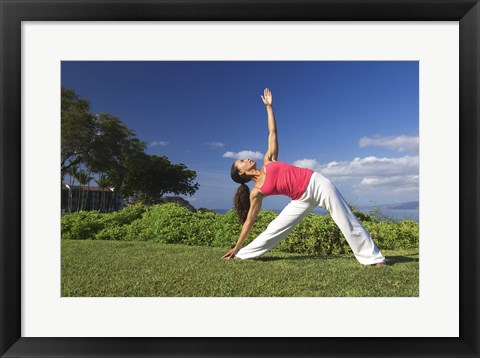 Framed Young woman practicing yoga, Maui, Hawaii, USA Print