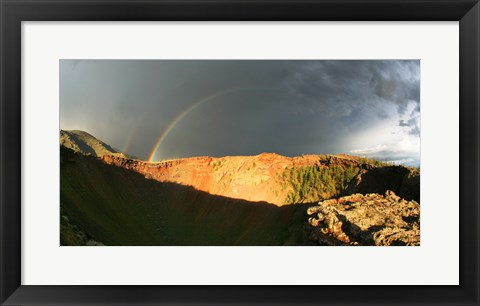 Framed Crater of an extinct volcano with a rainbow in the sky Print