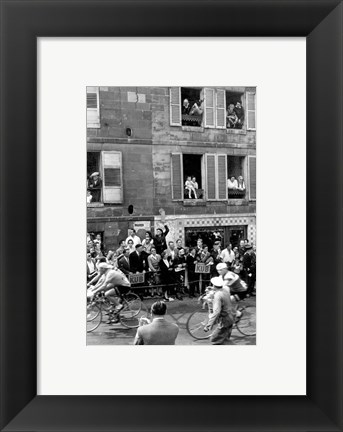 Framed People watching the cyclists being provisioned. Tour de France 1958. Print