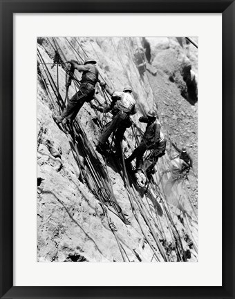 Framed Drillers at work on canyon wall above power plant location Print