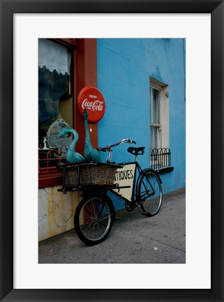 Framed Statues of swans in a basket on a bicycle, Lahinch, Ireland Print