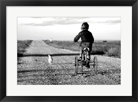 Framed Rear view of a girl riding a bicycle Print