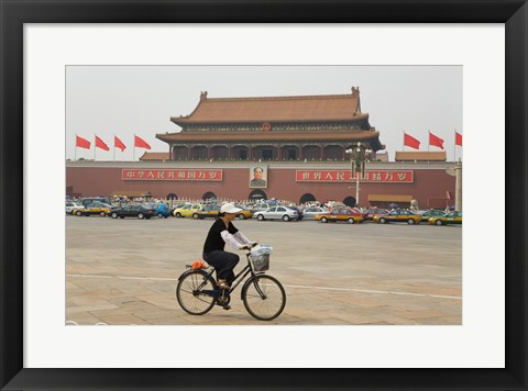Framed Tourist riding a bicycle at a town square, Tiananmen Gate Of Heavenly Peace, Tiananmen Square, Beijing, China Print