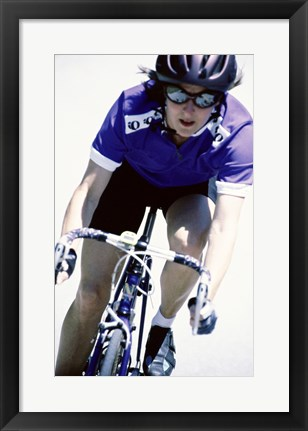 Framed Young woman riding a bicycle Print