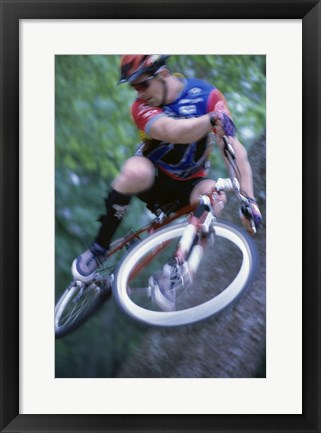 Framed Young man on a bicycle Print