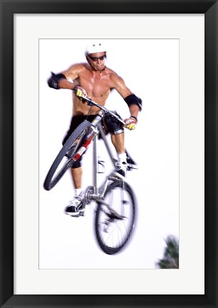 Framed Young man on a bicycle in mid-air Print