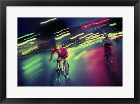 Framed Young man riding a bicycle Print