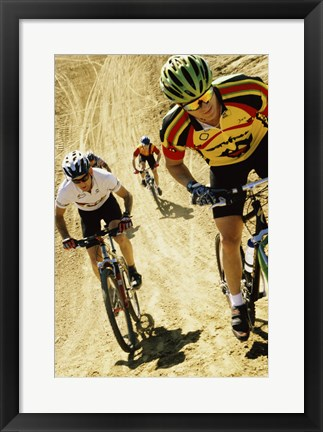 Framed Group of people riding bicycles in a race Print